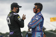 Jimmie Johnson, left, talks with Bubba Wallace before a NASCAR Cup Series auto race at Pocono Raceway, Sunday, June 28, 2020, in Long Pond, Pa. (AP Photo/Matt Slocum)