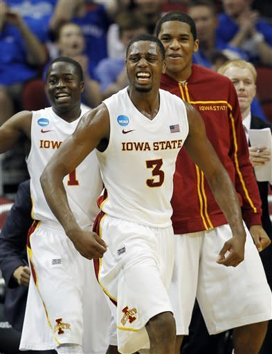 Iowa State forward Melvin Ejim (3) and guard Bubu Palo, left, react with teammates after a 3-pointer against Connecticut in the first half of their NCAA tournament second-round college basketball game in Louisville, Ky., Thursday, March 15, 2012. (AP Photo/John Bazemore)