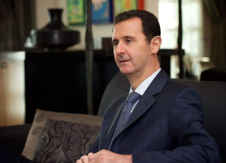 Syria's  President Bashar al-Assad is seen during an interview to the American magazine Foreign Affairs published on Monday in Damascus