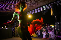 Rayne O'Plasty dances at Pride Park, a venue for artistic shows ahead the Pride 2021 in Bucharest, Romania, Thursday, Aug. 12, 2021. The 20th anniversary of the abolishment of Article 200, which authorized prison sentences of up to five years for same-sex relations, was one cause for celebration during the gay pride parade and festival held in Romania's capital this month. People danced, waved rainbow flags and watched performances at Bucharest Pride 2021, an event that would have been unimaginable a generation earlier. (AP Photo/Vadim Ghirda)
