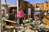 Patti Herring sorts through the debris of her home in Fultondale, Ala., on Tuesday, Jan. 26, 2021, after it was destroyed by a tornado. (AP Photo/Jay Reeves)