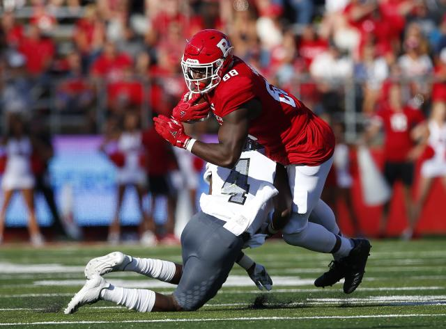 "Rutgers tight end <a class=""link rapid-noclick-resp"" href=""/ncaaf/players/251246/"" data-ylk=""slk:Jerome Washington"">Jerome Washington</a> hauled in a pass against Nebraska with a couple of lucky bounces and some strong lower-body muscles. (Getty Images)"