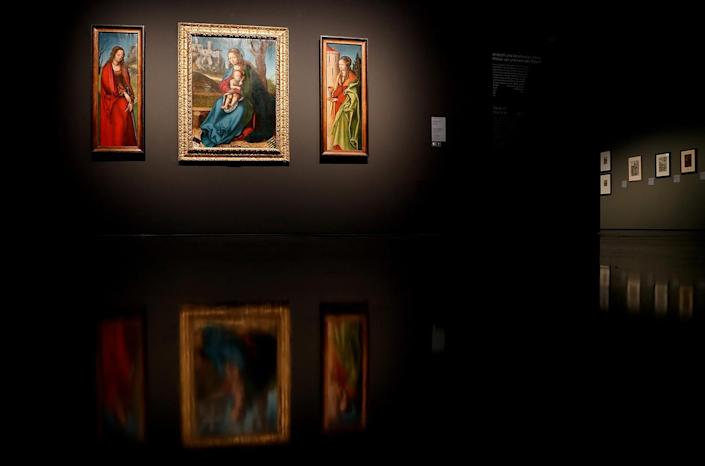 <p>Altarpiece of the Virgin, about 1513/14, painting on lime wood, St Catherine (L), St Barbara (R) and Virgin and Child on a Grassy Bank (C) is displayed in the exhibition Cranach 'Meister – Marke – Moderne' in the Museum Art Palace in Duesseldorf, Germany, April 6, 2017. Photo: Friedemann Vogel/EPA) </p>