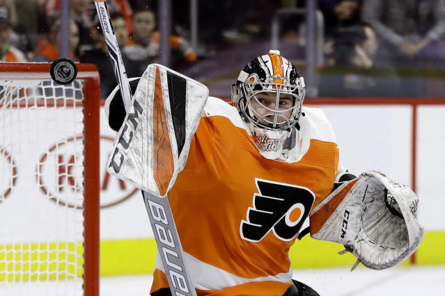 In this Dec. 20, 2018, file photo, Philadelphia Flyers' Carter Hart blocks a shot during the third period of an NHL hockey game against the Nashville Predators, in Philadelphia. Vigneault, a master of quick fixes who led Vancouver and the New York Rangers to the Stanley Cup Final, was hired as the latest coach to try and win a championship for the Flyers. (AP Photo/Matt Slocum, File)