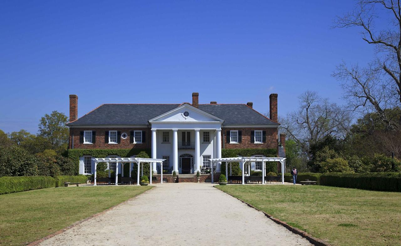 """<p>Established in 1681 by Englishman Major John Boone, <a href=""""https://www.boonehallplantation.com/"""" target=""""_blank"""">Boone Hall Plantation</a> is one of America's oldest working farms. Once known for growing cotton and pecans, today the plantation grows strawberries, peaches, tomatoes, and other produce which it sells via U-pick fields on the property and at a nearby market. The plantation's signature allée of live oak trees was planted in 1743; it took two centuries for the moss-covered branches to meet overhead. </p><p>The plantation offers tours of the main house (built in 1936), the plantation farms, and the gardens, which feature antique roses over 100 years old. It's also the only plantation in the South Carolina Lowcountry to offer a live presentation of Gullah culture.<strong></strong></p>"""