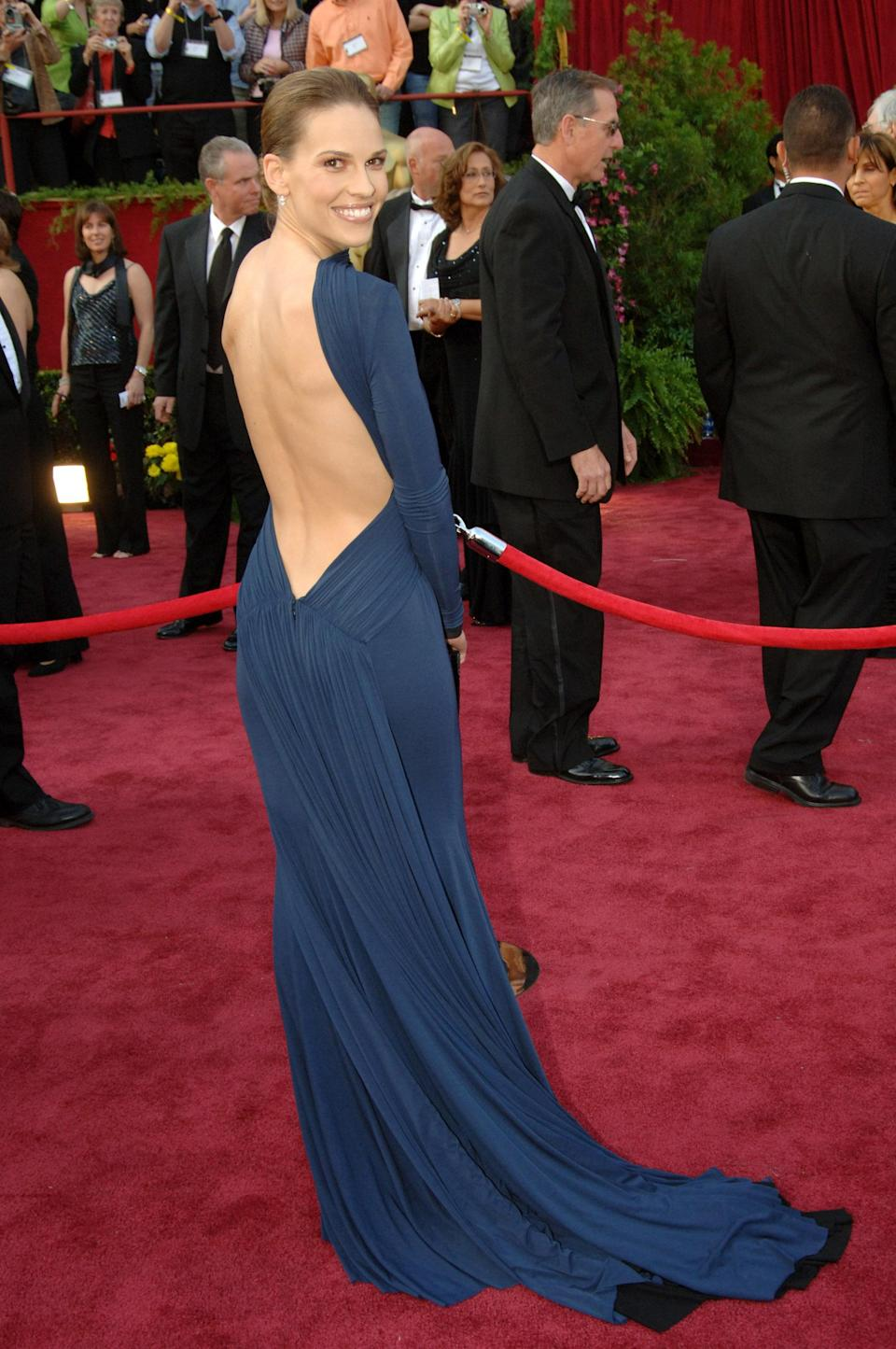 Hilary's backless, navy blue Guy Laroche dress remains as famous today as it was in 2005. In a poll by Debenhams published in <em>The Daily Telegraph</em> the dress was voted the 16th greatest red carpet gown of all time.