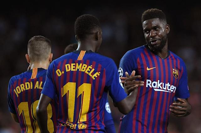 Barcelona's World Cup winning centre-back Samuel Umtiti is set to return to training this month after struggling with a knee injury (AFP Photo/LLUIS GENE)