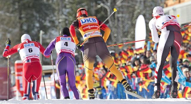 Athletes ski in the stadium during the individual Gundersen competition at the Nordic Combined FIS World Cup in Oberstdorf, southern Germany, Sunday, Jan. 26, 2014. (AP Photo/Jens Meyer)
