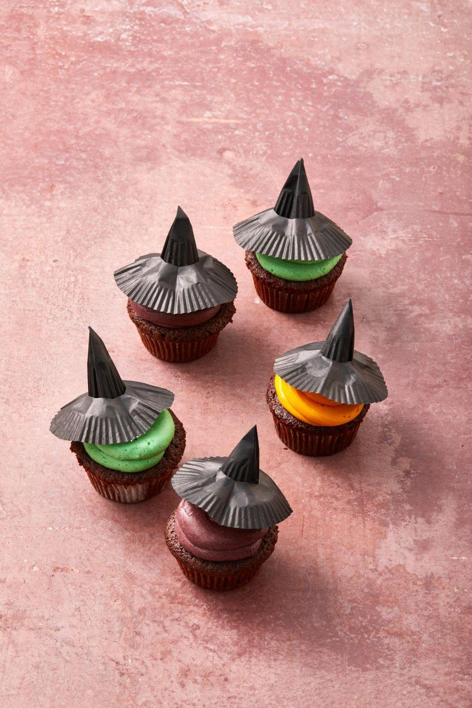"""<p>Hat's off to these witchy Halloween <a href=""""https://www.goodhousekeeping.com/food-recipes/a28566002/chocolate-cupcakes-recipe/"""" rel=""""nofollow noopener"""" target=""""_blank"""" data-ylk=""""slk:chocolate cupcakes"""" class=""""link rapid-noclick-resp"""">chocolate cupcakes</a> topped with buttercream frosting and crafty cupcake liners.</p><p><em><a href=""""https://www.goodhousekeeping.com/food-recipes/dessert/a33460086/witch-cupcakes-recipe/"""" rel=""""nofollow noopener"""" target=""""_blank"""" data-ylk=""""slk:Get the recipe for Witch Cupcakes »"""" class=""""link rapid-noclick-resp"""">Get the recipe for Witch Cupcakes »</a></em></p>"""