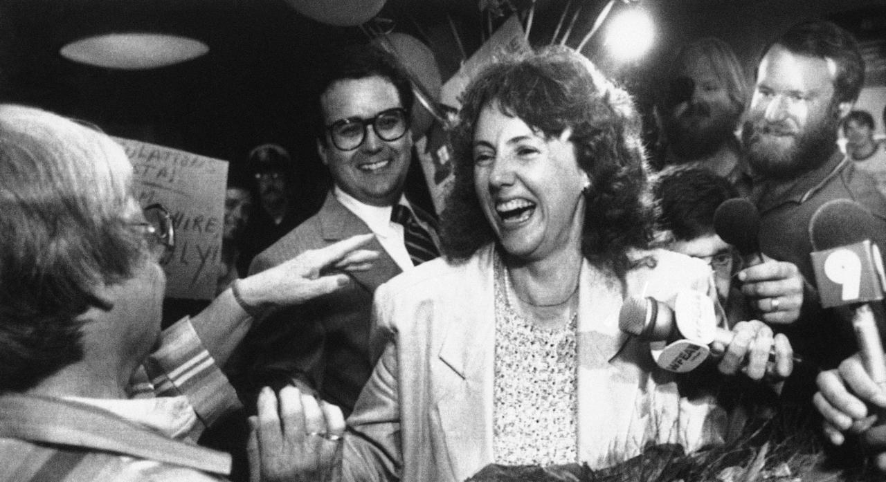 High school teacher Christa McAuliffe greets family and friends at Manchester Airport, July 20, 1985. McAuliffe was announced on Friday as the school teacher that would be the first citizen to go up in space aboard the Space Shuttle. (AP Photo/Jim Cole)