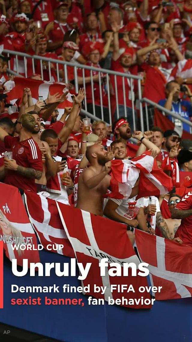 FIFA has hit the Danish Danish Football Association with a $20,400 fine and issued a warning after Danish World Cup fans displayed a sexist banner and created crowd disturbances during Denmark's 1-1 draw with Australia on Thursday.