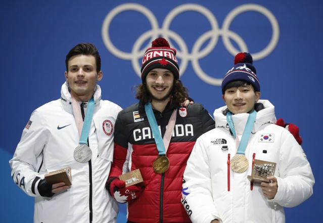 Medals Ceremony - Short Track Speed Skating Events - Pyeongchang 2018 Winter Olympics - Men's 1000m - Medals Plaza - Pyeongchang, South Korea - February 18, 2018 - Gold medalist Samuel Girard of Canada, silver medalist John-Henry Krueger of the U.S. and bronze medallist Seo Yi-ra of South Korea on the podium. REUTERS/Kim Hong-Ji