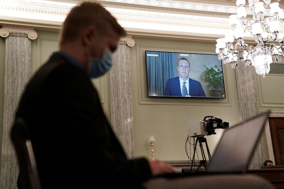 Facebook CEO Mark Zuckerberg appears on a screen as he speaks remotely during a hearing before the Senate Commerce Committee on Capitol Hill on Oct. 28, 2020, in Washington. The committee summoned the CEOs of Twitter, Facebook and Google to testify during the hearing.