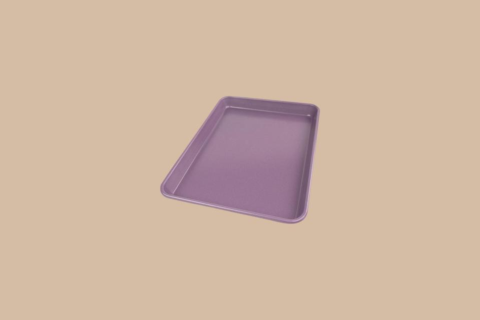 """<p>Not just a pretty pan, this striking sheet is also a hero at preventing cross contamination. Keep a colorful baking sheet on hand for when you are cooking for someone with <a href=""""https://www.marthastewart.com/7616556/food-allergies-intolerances-differences"""" rel=""""nofollow noopener"""" target=""""_blank"""" data-ylk=""""slk:food allergies"""" class=""""link rapid-noclick-resp"""">food allergies</a>, because having one pan out of a few that is this lavender color will help keep the gluten-free or nut-free batch separate from the others.</p> <p><strong><em>Shop Now:</em></strong><em> USA Pan Allergy ID Sheet Pan, $24, <a href=""""http://surlatable.aiy7.net/c/249354/635796/10190?subId1=MSLOurShoppableGuidetoSheetPansandCookieSheetsvspence2FooGal7847984202007I&u=https%3A%2F%2Fwww.surlatable.com%2Fusa-pan-allergy-id-quarter-sheet%2FPRO-5849161.html"""" rel=""""nofollow noopener"""" target=""""_blank"""" data-ylk=""""slk:surlatable.com"""" class=""""link rapid-noclick-resp"""">surlatable.com</a>.</em></p>"""