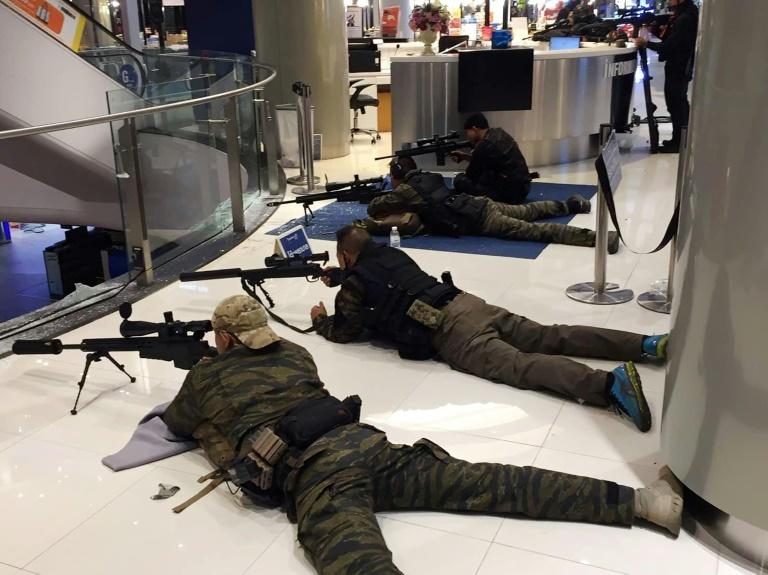 Police took positions near an escalator in the Terminal 21 shopping mall as they attempted to end the rampage by Thai soldier Jakrapanth Thomma (AFP Photo/Handout)