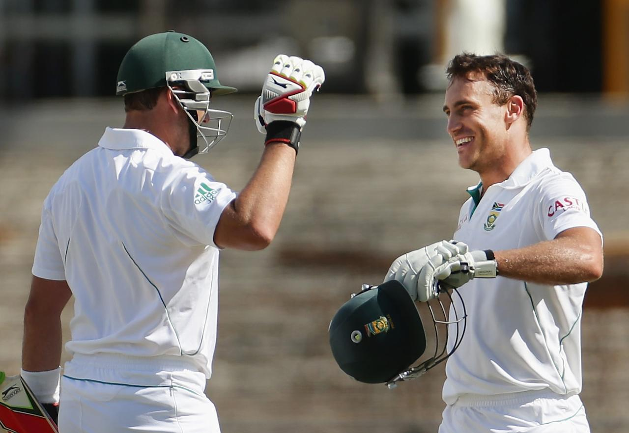 ADELAIDE, AUSTRALIA - NOVEMBER 26:  Faf du Plessis of South Africa is congratulated by Jacques Kallis of South Africa after reaching his century during day five of the Second Test Match between Australia and South Africa at Adelaide Oval on November 26, 2012 in Adelaide, Australia.  (Photo by Scott Barbour/Getty Images)