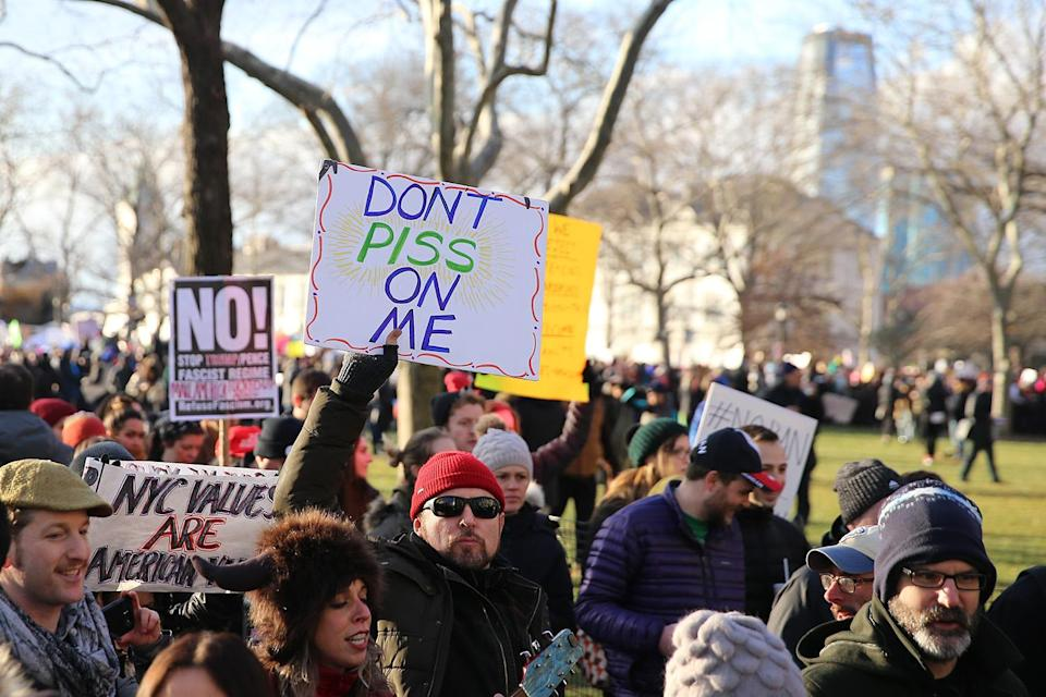 <p>A man holds up a sign during a rally in New York's Battery Park on Jan. 29, 2017, protesting President Donald Trump's immigration order. (Gordon Donovan/@YahooNews) </p>