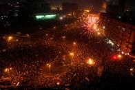 FILE PHOTO: General view of Tahrir Square as fireworks explode during a pro-democracy supporters' celebration in Cairo