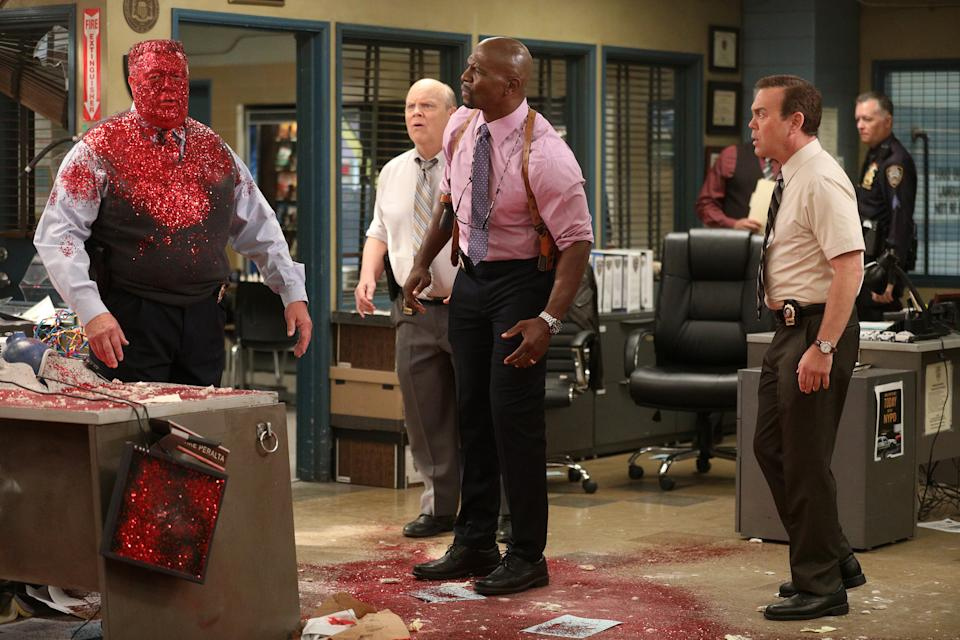 """BROOKLYN NINE-NINE -- """"Dillman"""" Episode 709 -- Pictured: (l-r) Joel McKinnon Miller as Scully, Dirk Blocker as Hitchcock, Terry Crews as Terry Jeffords, Joe Lo Truglio as Charles Boyle -- (Photo by: Jordin Althaus/NBC/NBCU Photo Bank via Getty Images)"""