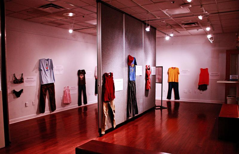"A photo of the art exhibit ""What Were You Wearing?"" at the University of Kansas."