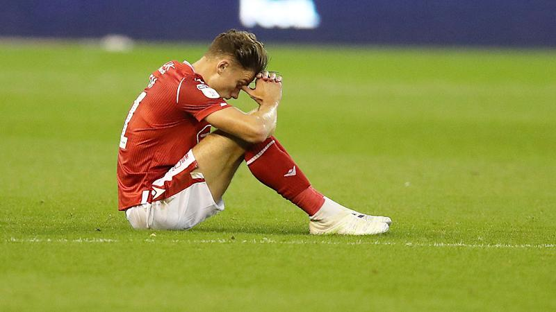 Matty Cash of Nottingham Forest looks dejected after they fail to qualify for the play-offs.
