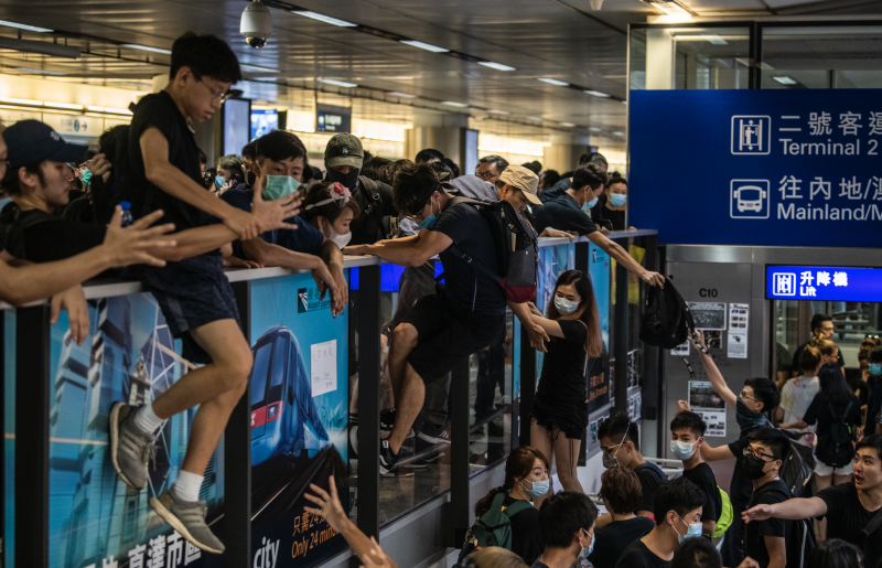 Protester are seen climbing onto the airport express station in Hong Kong International Airport in Hong Kong on August 12, 2019. (Photo: Vernon Yuen/NurPhoto via Getty Images)