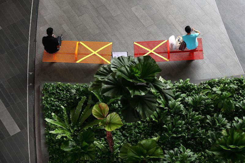 """X"" marks the spot: People in Singapore practicing social distancing last month. (Photo: Suhaimi Abdullah/Getty Images)"