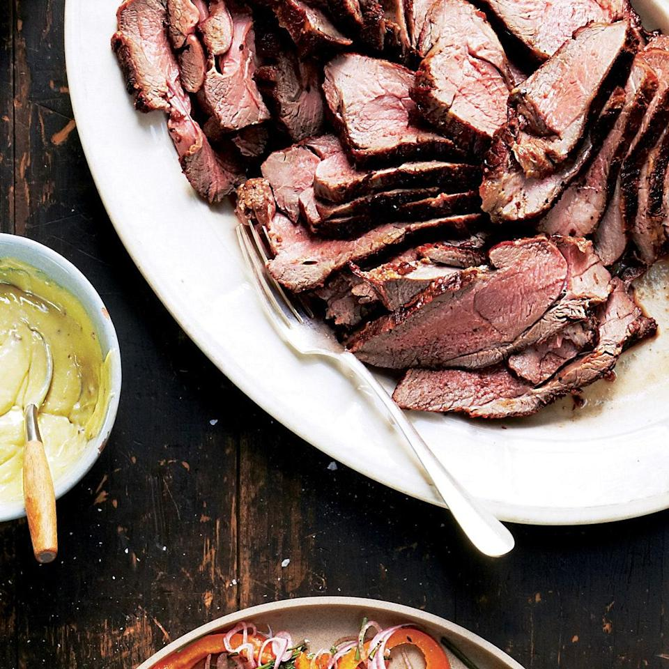 """Save time (and stress) by grilling the lamb a few hours ahead of time and slicing it at room temperature. <a href=""""https://www.epicurious.com/recipes/food/views/grilled-leg-of-lamb-with-herb-salt-51241970?mbid=synd_yahoo_rss"""" rel=""""nofollow noopener"""" target=""""_blank"""" data-ylk=""""slk:See recipe."""" class=""""link rapid-noclick-resp"""">See recipe.</a>"""