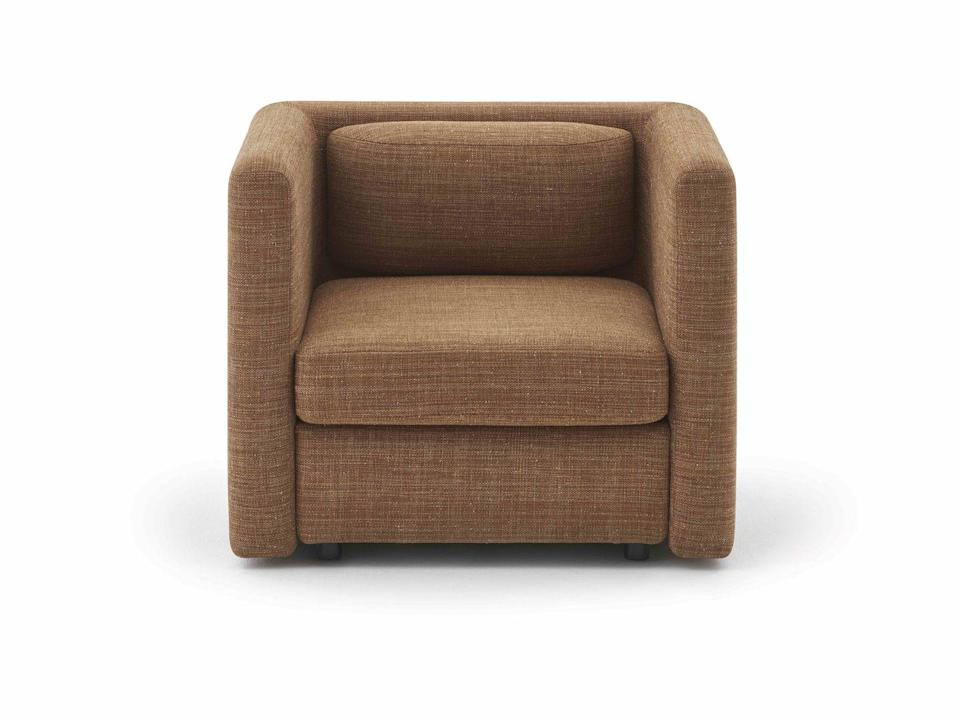 """<p>'Virgule' by Christophe Delcourt for Pierre Frey is a nuanced design that merges minimalist lines and soft curves. A modular system, it comprises corner units, sofa sections and standalone pieces, such as this armchair, that can be combined in various ways. From approx £1,091, <a href=""""https://www.pierrefrey.com/en/"""" rel=""""nofollow noopener"""" target=""""_blank"""" data-ylk=""""slk:pierrefrey.com"""" class=""""link rapid-noclick-resp"""">pierrefrey.com</a></p>"""