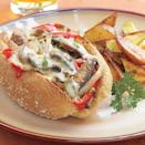 """<p>Cheese steaks are a Philadelphia tradition: thin slices from a rich and very fatty slab of beef, fried up and topped with a heavy cheese sauce. We've cut down on the fat considerably--but not on the taste. All it needs is a cold beer or a glass of pinot noir on the side. <a href=""""https://www.eatingwell.com/recipe/248986/portobello-philly-cheese-steak-sandwich/"""" rel=""""nofollow noopener"""" target=""""_blank"""" data-ylk=""""slk:View Recipe"""" class=""""link rapid-noclick-resp"""">View Recipe</a></p>"""