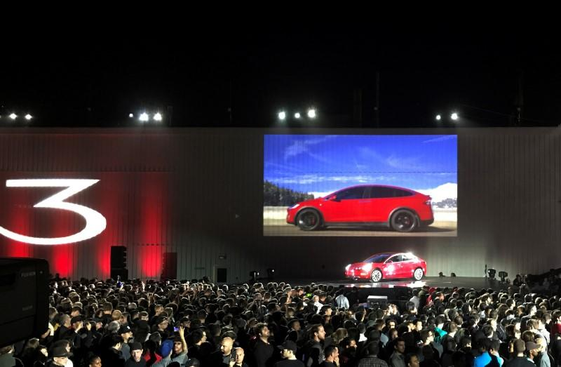 Tesla introduces one of the first Model 3 cars off the Fremont factory's production line during an event at the company's facilities in Fremont,
