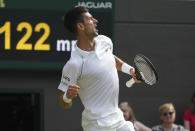 Serbia's Novak Djokovic celebrates winning a point against Denis Kudla of the US during the men's singles third round match on day five of the Wimbledon Tennis Championships in London, Friday July 2, 2021. (AP Photo/Alberto Pezzali)