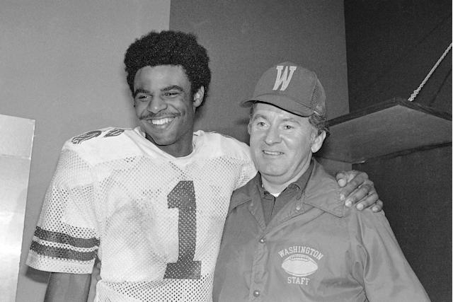 FILE - In this Jan. 2, 1978 file photo, University of Washington Huskies' Warren Moon (1) poses with coach Don James after the Rose Bowl in Pasadena. James, the longtime Washington football coach who led the Huskies to a share of the national championship in 1991, died Sunday, Oct. 20, 2013. He was 80. (AP Photo/File)