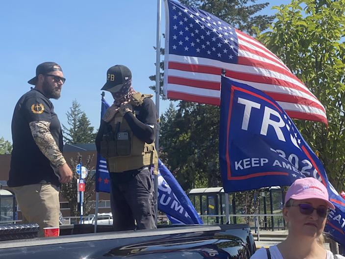 Men wearing symbols of the Proud Boys at a pro-Trump truck caravan Sept. 7 near Portland, Ore.