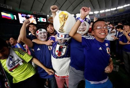 Japanese fans celebrate the victory after the World Cup Group H soccer match Colombia vs Japan, at a public viewing event at Tokyo Dome in Tokyo, Japan June 19, 2018. REUTERS/Issei Kato