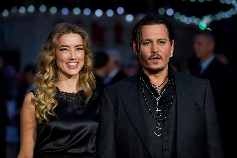 Johnny Depp and ex-wife Amber Heard in 2015 (JUSTIN TALLIS/AFP/Getty Images)