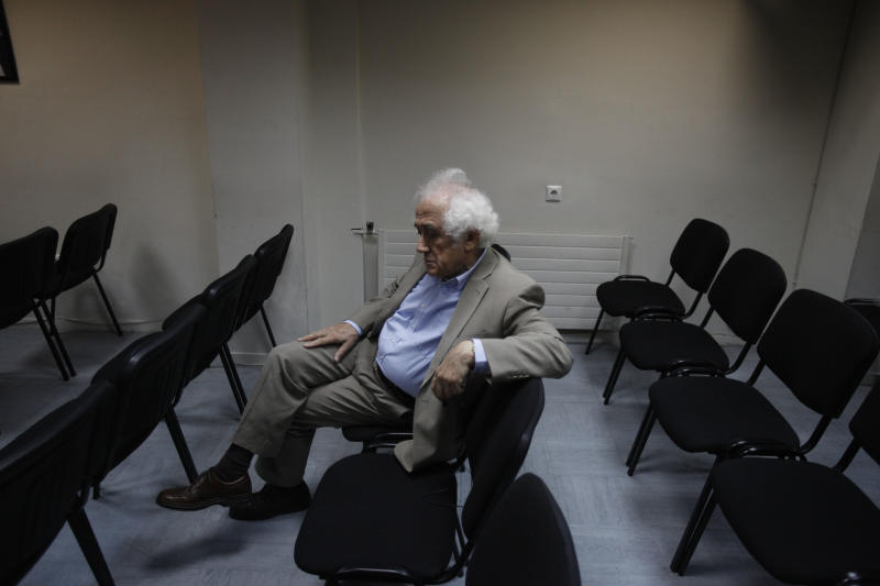 Greek Justice Minister Antonis Roupakiotis waits before a meeting with the lawmakers of Democratic Left party and leader Fotis Kouvelis, in Athens, Friday, June 21, 2013. Greece's shaky coalition government was reeling Friday after one of its junior partners rejected a crucial compromise deal on the future of the state broadcaster and concerns over the country's bailout intensified. The latest pressure on the country comes after one of the junior partners in the coalition, the Democratic Left, rejected a compromise deal over last week's surprise decision by conservative Prime Minister Antonis Samaras to close public broadcaster ERT. The other junior partner, socialist Pasok, accepted the deal. (AP Photo/Kostas Tsironis)