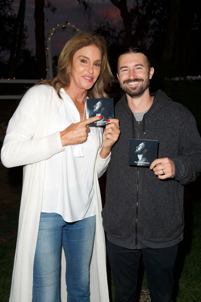 "Caitlyn Jenner and Brandon Jenner pose for a photo at the Brandon Jenner Record Release Party For ""Burning Ground"" on November 19, 2016 in Malibu, California. (Photo by Earl Gibson III/Getty Images)"