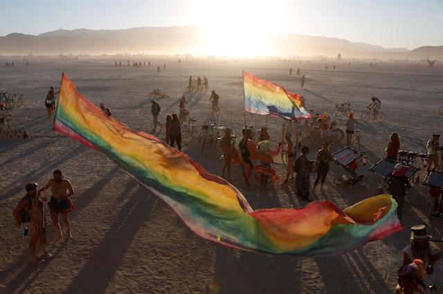 <p>The sun sets on the playa as approximately 70,000 people from all over the world gathered for the annual Burning Man arts and music festival in the Black Rock Desert of Nevada, Aug. 28, 2017. (Photo: Jim Urquhart/Reuters) </p>