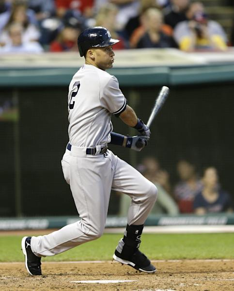 New York Yankees' Derek Jeter hits a single off Cleveland Indians relief pitcher Vinnie Pestano in the sixth inning of a baseball game Thursday, July 10, 2014, in Cleveland. (AP Photo/Tony Dejak)