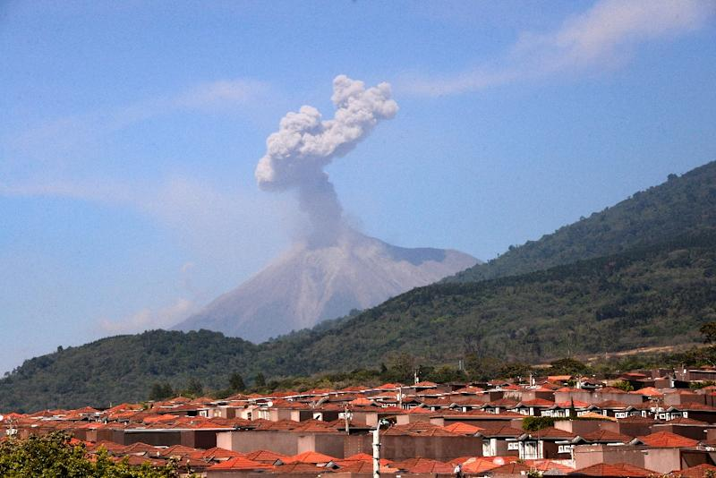 Ash billowing from the Fuego volcano is seen from the Palin municipality, Escuintla departament, 40 km south of Guatemala City on February 13, 2015