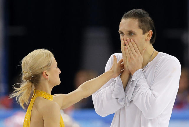 Tatiana Volosozhar and Maxim Trankov of Russia react after they competed in the pairs free skate figure skating competition at the Iceberg Skating Palace during the 2014 Winter Olympics, Wednesday, Feb. 12, 2014, in Sochi, Russia. (AP Photo/Vadim Ghirda)