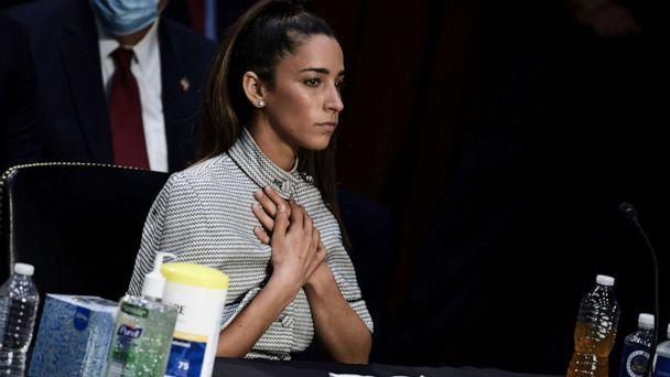 PHOTO: U.S. Olympic Gymnast Aly Raisman closes her eyes as NCAA and world champion gymnast Maggie Nichols gives her testimony during a Senate Judiciary hearing about the Larry Nassar investigation of sexual abuse, on Sept. 15, 2021, in Washington, D.C. (Anna Moneymaker/Getty Images)