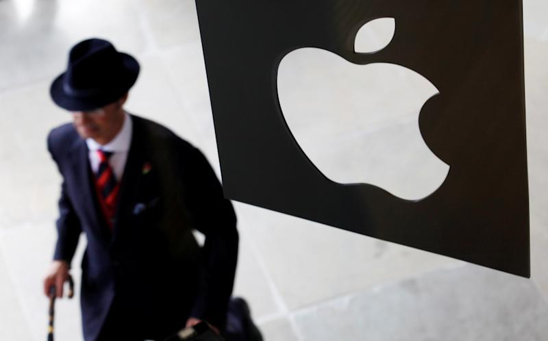 A customer enters the new Apple store, which is the world's largest, on its opening day at Covent Garden in London