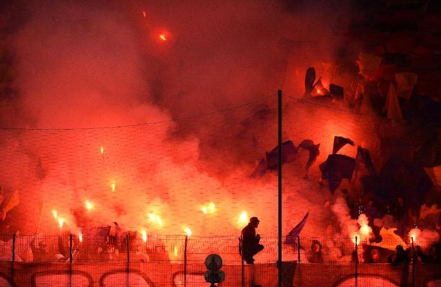 Hardcore football fans show their passion at the bitterly contested derby between Romania's Dinamo Bucharest and Steaua (AFP Photo/Daniel Mihailescu)