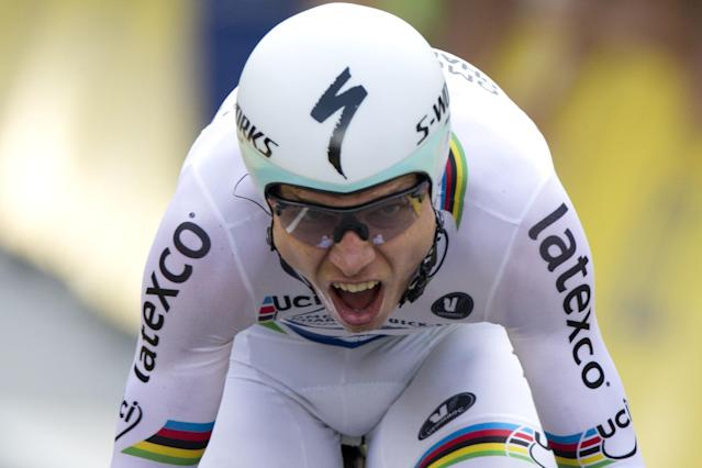 Germany's Tony Martin crosses the finish line of the twentieth stage of the Tour de France cycling race, an individual time-trial over 54 kilometers (33.6 miles) with start in Bergerac and finish in Perigueux, France, Saturday, July 26, 2014. (AP Photo/Peter Dejong)
