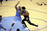 Sacramento Kings' Marvin Bagley, right, pushes past Houston Rockets' PJ Tucker during the first half of an NBA basketball game, Thursday Dec. 31, 2020, in Houston. (AP Photo/Richard Carson)
