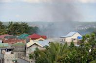 Smoke billows from a burning house during the standoff between Muslim gunmen and army troops in Zamboanga City, on the southern island of Mindanao on September 10, 2013