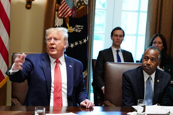 US President Donald Trump takes part in a cabinet meeting in the Cabinet Room of the White House in Washington, DC on November 19, 2019 as Ben Carson, Secretary of Housing and Urban Development looks on. (Photo by MANDEL NGAN / AFP) (Photo by MANDEL NGAN/AFP via Getty Images)