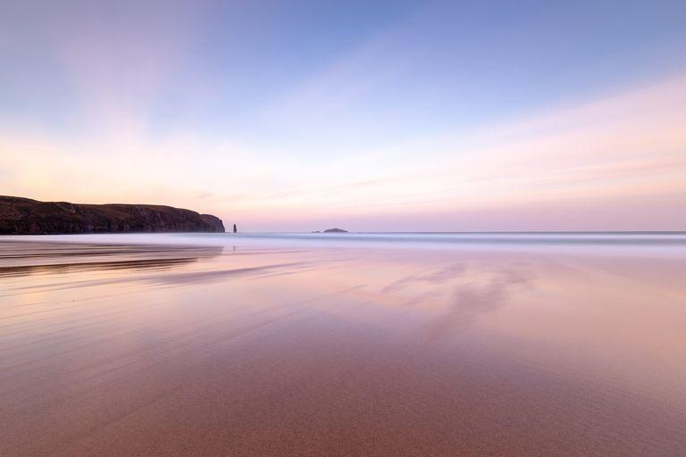 <p>Who says Scotland doesn't have brilliant beaches? Sandwood Bay in Sutherland is one mile long and best known for Am Buachaille, a sea stack. The beach lies about 5 miles south of Cape Wrath.</p>